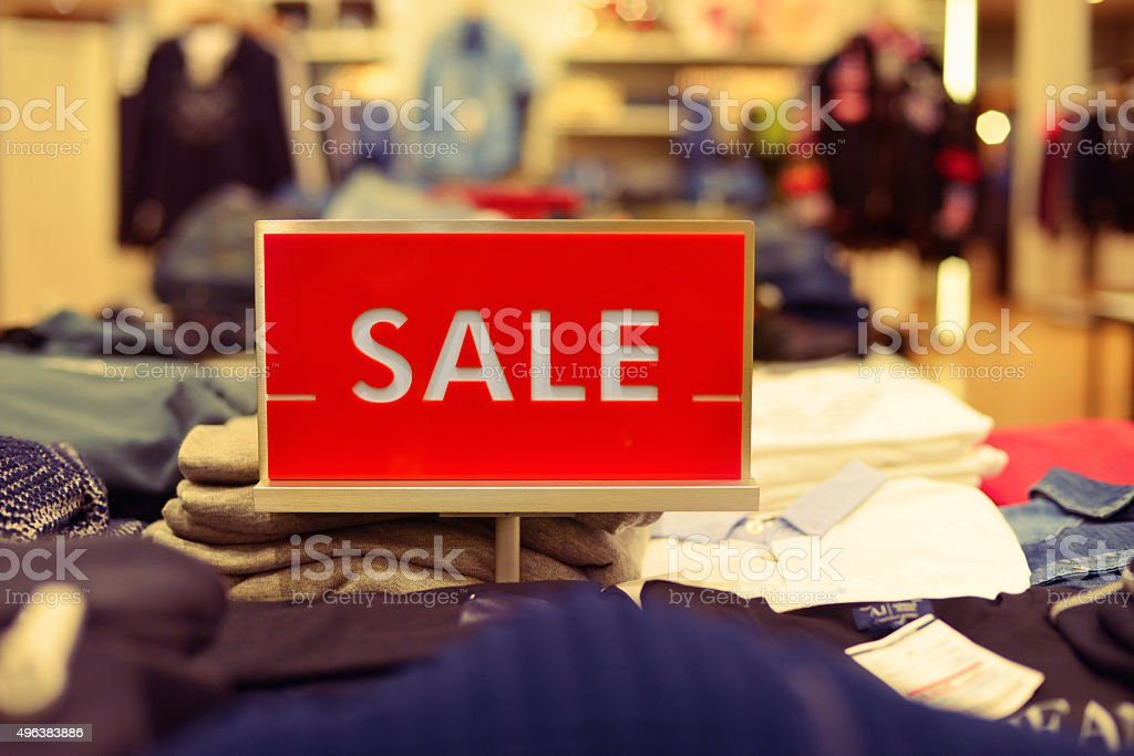 Red sale sign in the boutique shop. stock photo