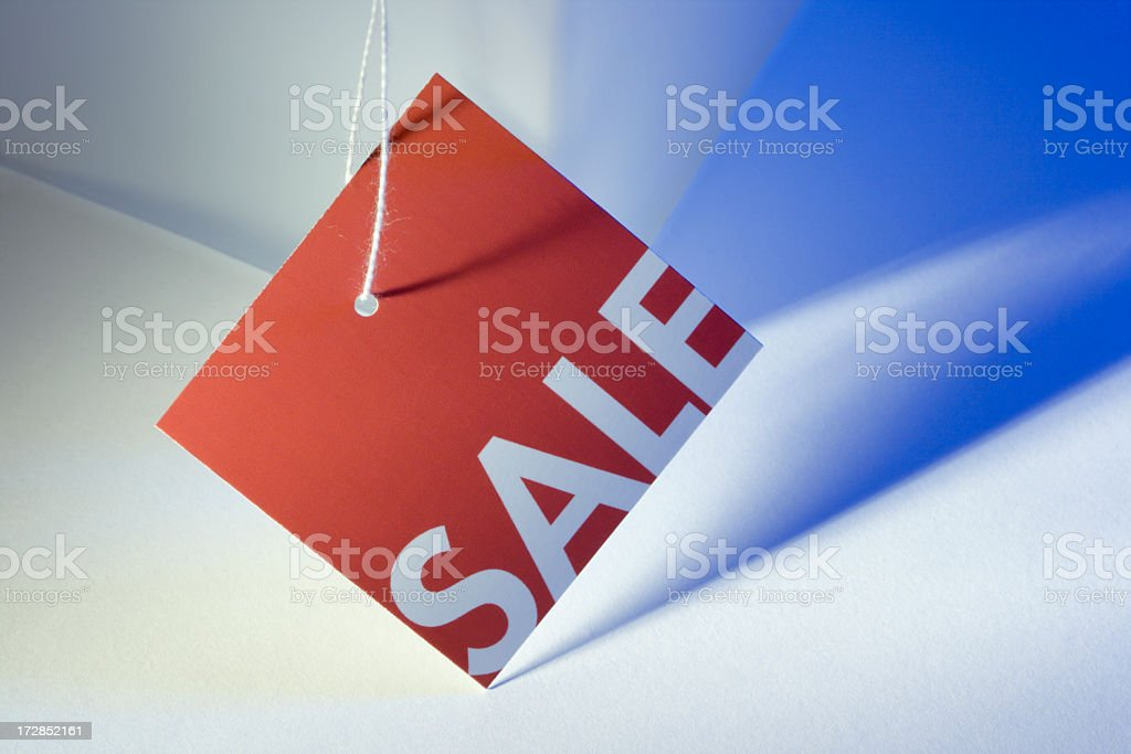 Red Sale Tag on Blue and White for Retail Discount stock photo