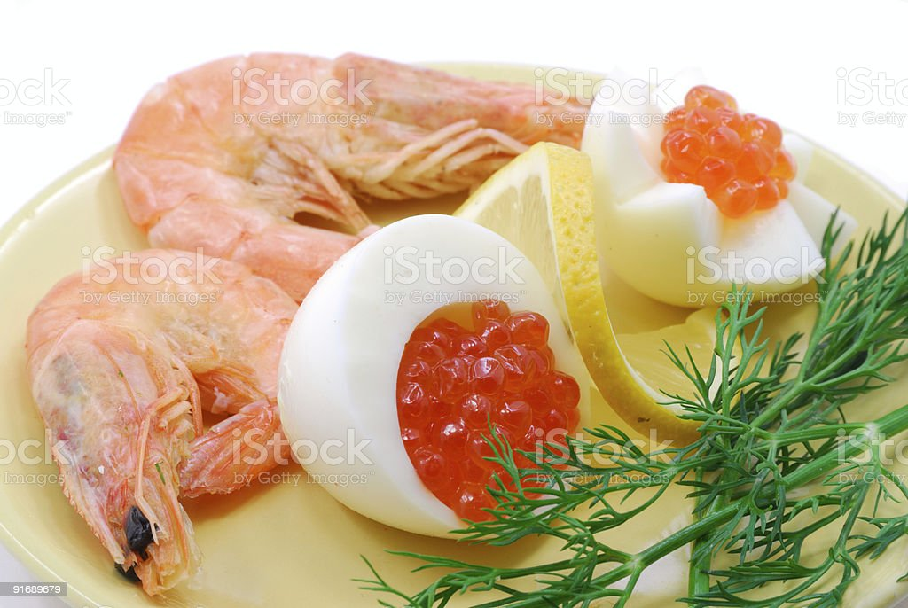 Red salmon caviar and cooked shrimps royalty-free stock photo