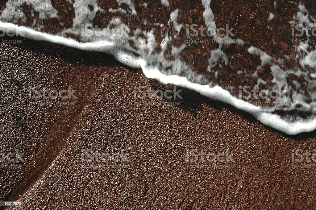 Red sand and frothy water Hana, Maui, Hawaii royalty-free stock photo