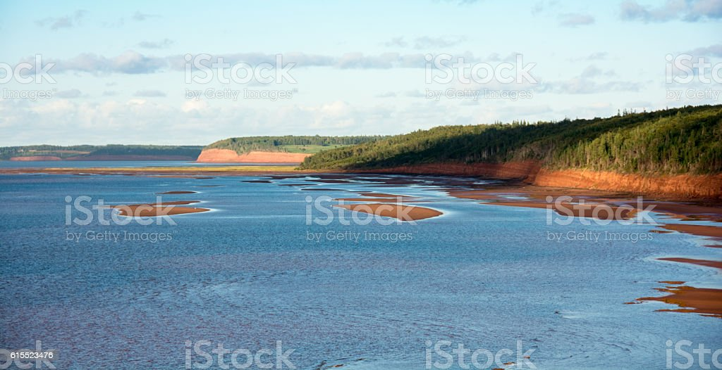 Red  sand and tide flats of Prince Edward Island stock photo