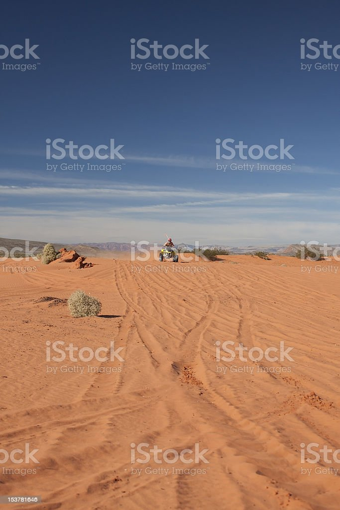Red Sand Dunes with Racing Fourwheeler stock photo
