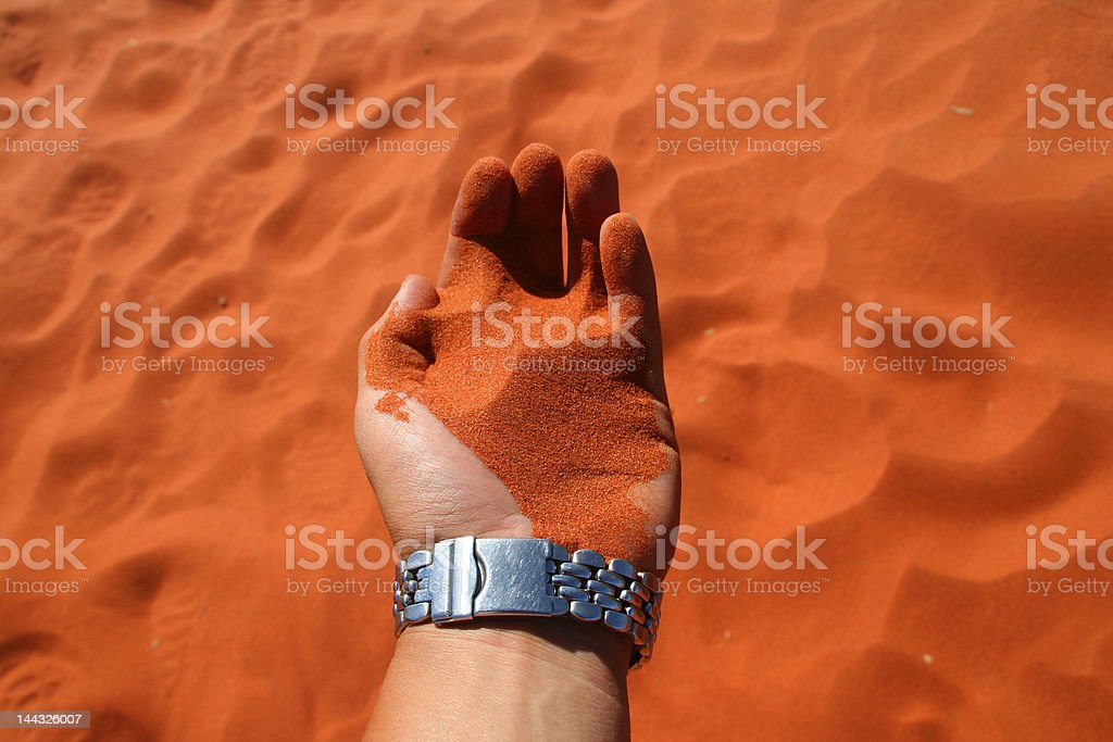 Red Sand in Hand royalty-free stock photo