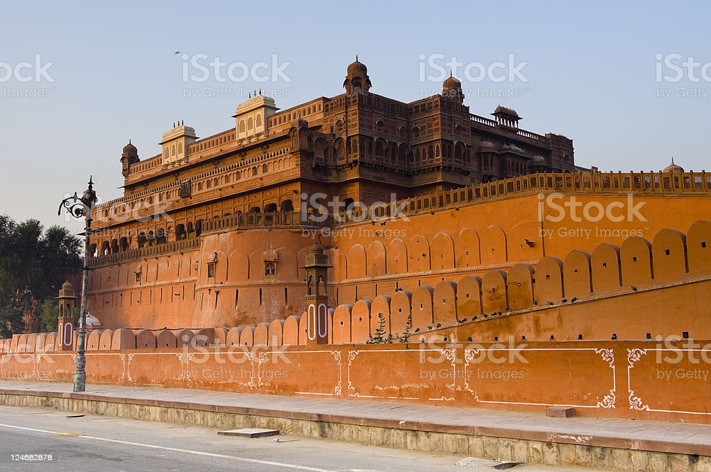 Red sandstone fort under blue sky in morning stock photo