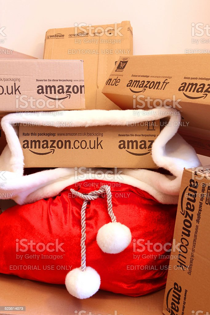 Red Santa's Sack with Amazon boxes - Holiday Shopping Online stock photo