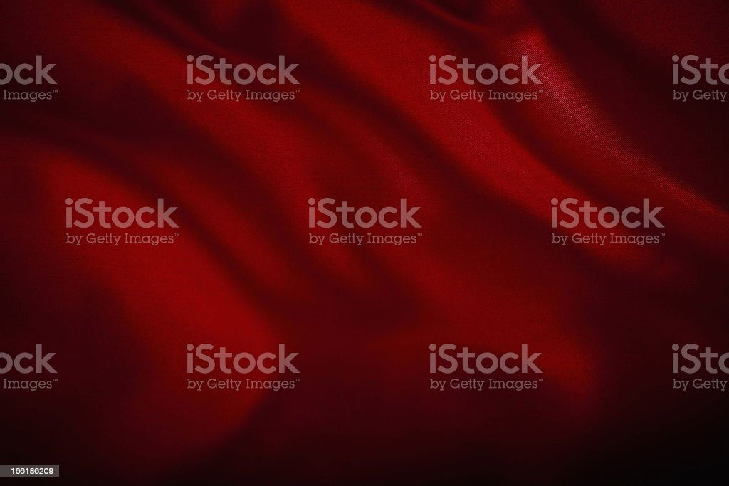 A red satin cloth background with wrinkles stock photo