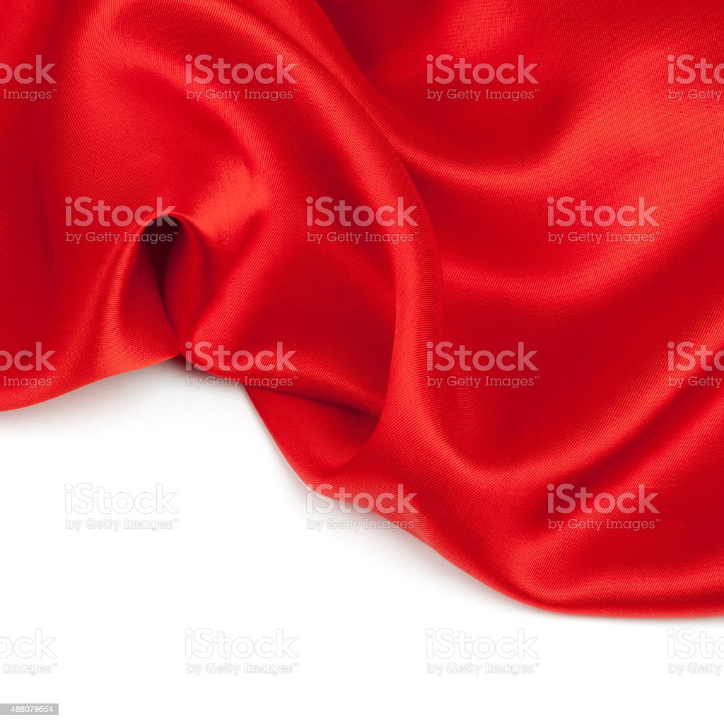 Red satin fabric against white background stock photo