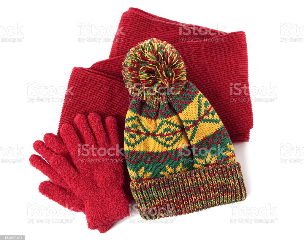 Red scarf and gloves with yellow and green knit beanie stock photo