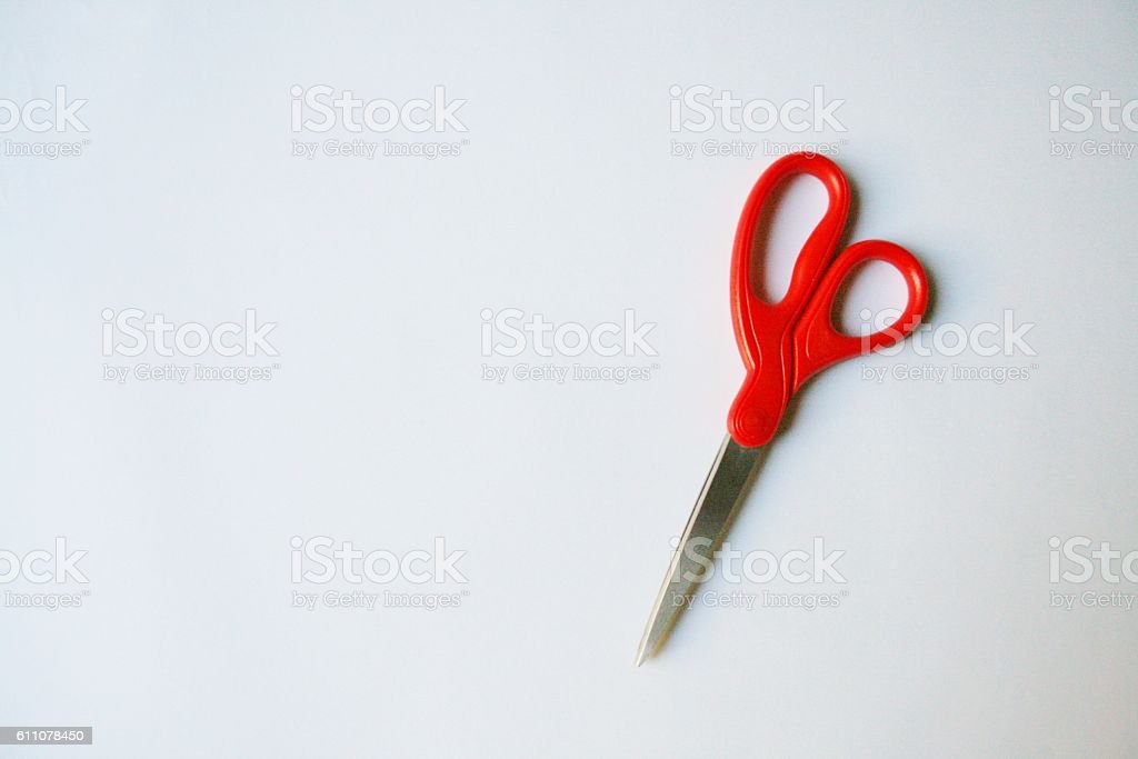 Red scissors isolated on white background stock photo