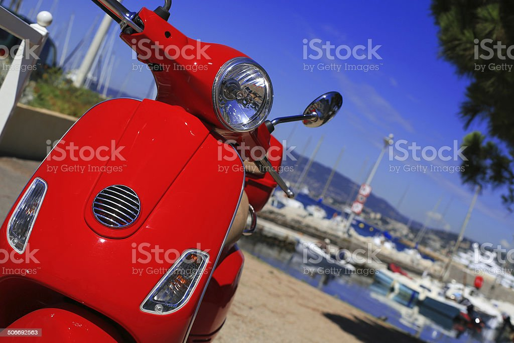 Red scooter against the sea royalty-free stock photo