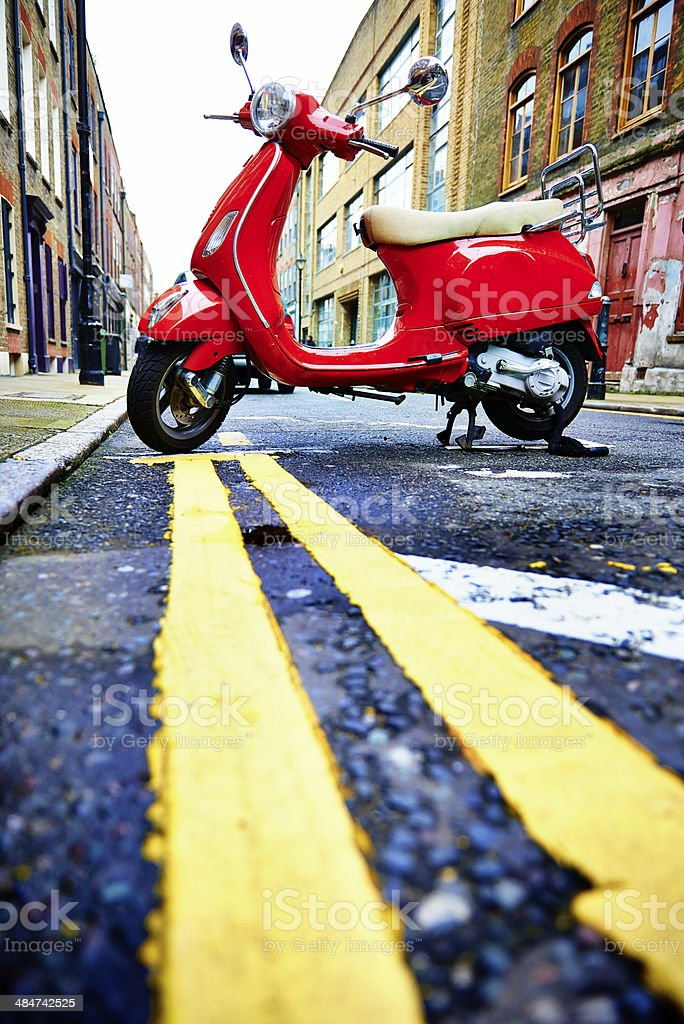 Red scooter in a little street in London royalty-free stock photo