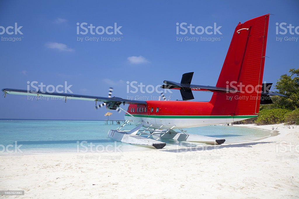 Red sea plane on a tropical beach stock photo