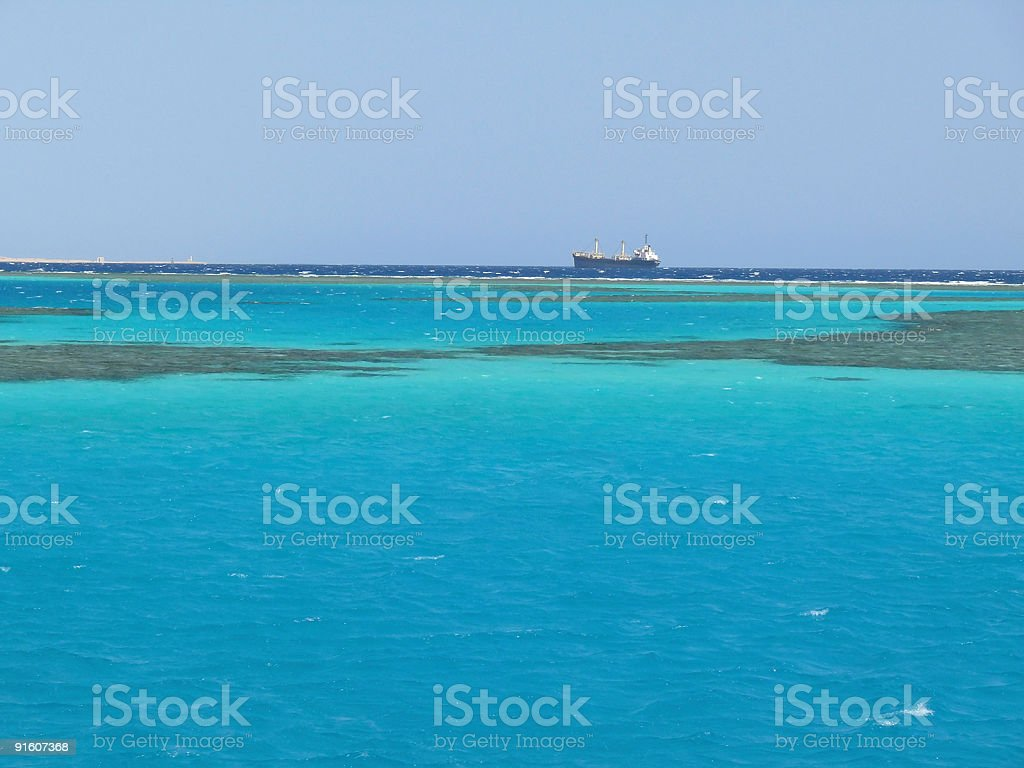 Red Sea reef and tanker royalty-free stock photo