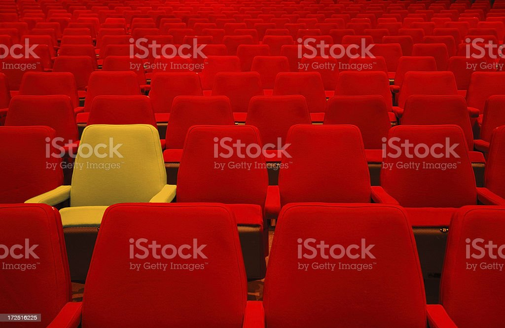 Red seats and one different stock photo