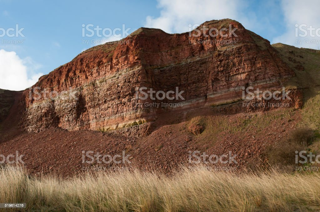 Red sedimentary rock cliffs, island Helgoland. stock photo