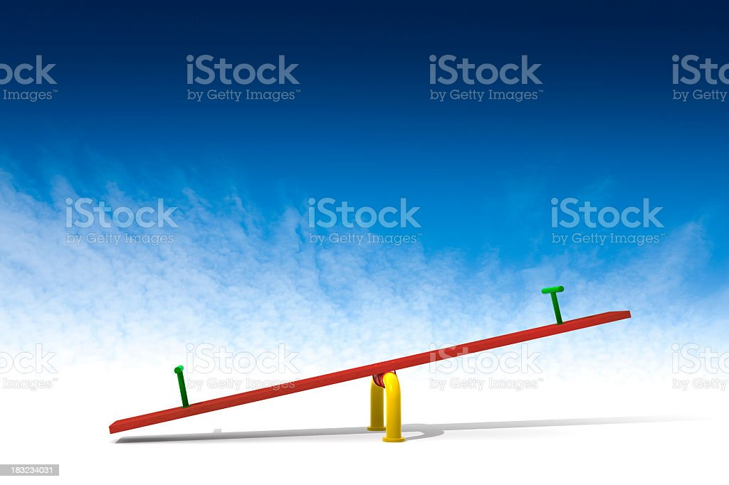 Red seesaw in front of a blue background stock photo
