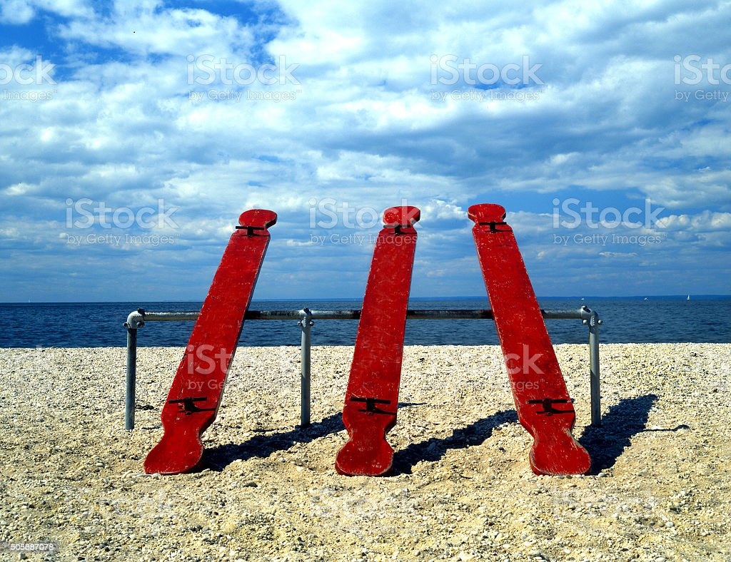 red seesaws stock photo