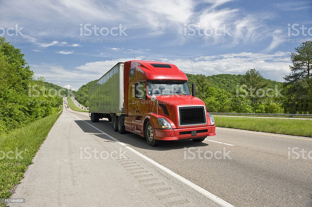 Red Semi Truck On Interstate In Springtime royalty-free stock photo