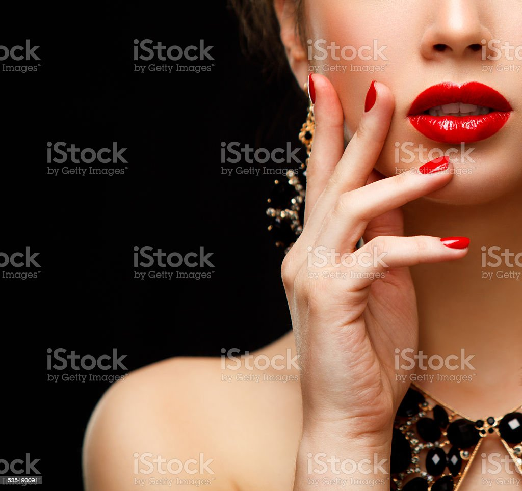 Red Sexy Lips and Nails closeup. Manicure and Makeup stock photo