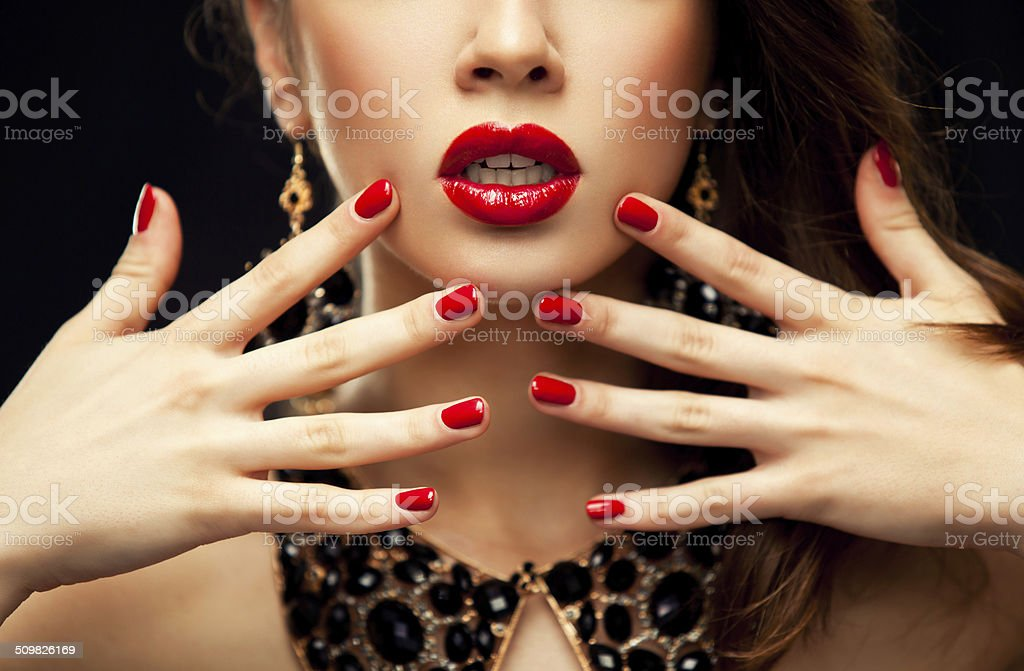 Red Sexy Lips and Nails closeup stock photo