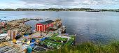 Red shack on dock, garden boxes along Twillingate village shoreline.