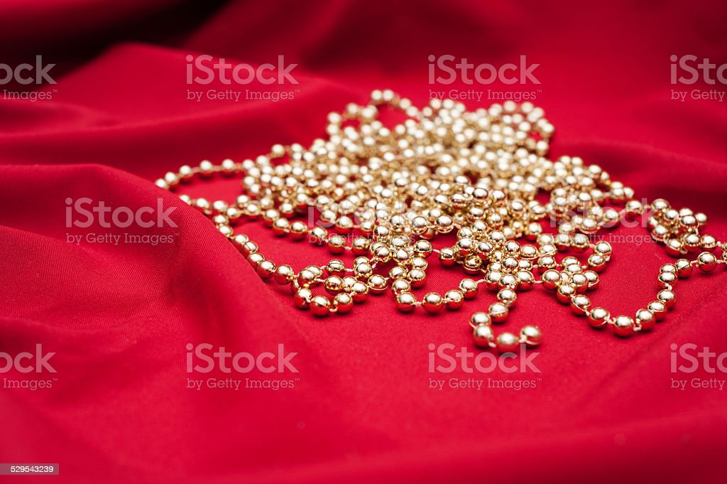 Red sheet with christmas decoration perls stock photo
