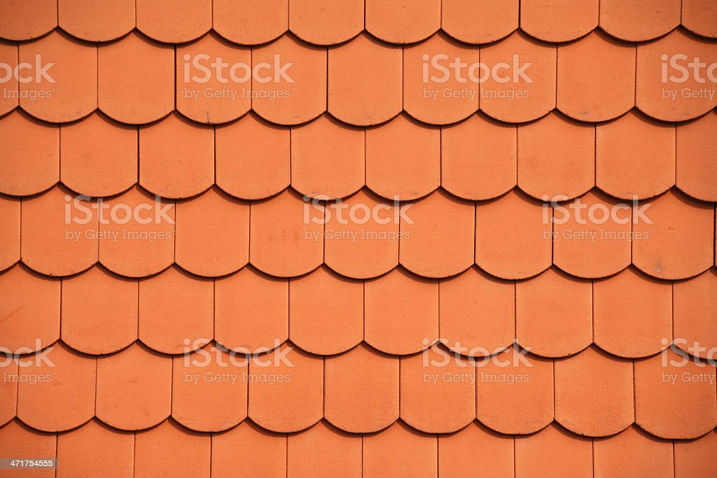 Red shingles on a roof stock photo