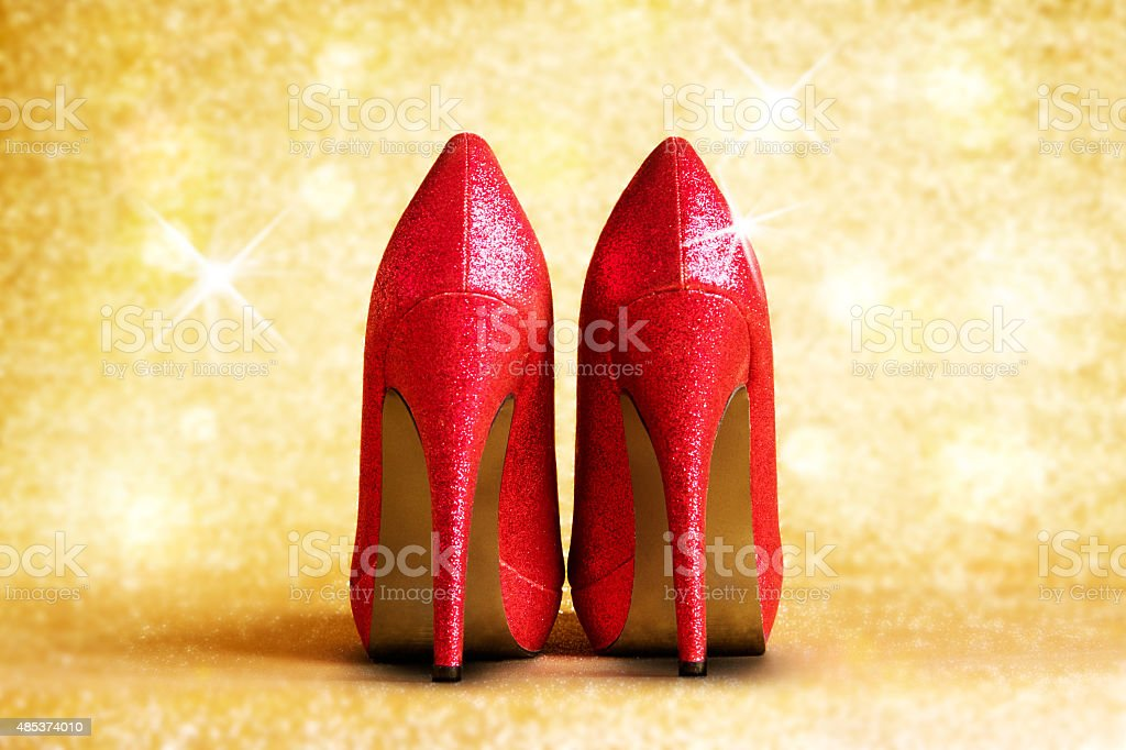 Red shining high heel with illumination background.Christmas New Year's shopping stock photo
