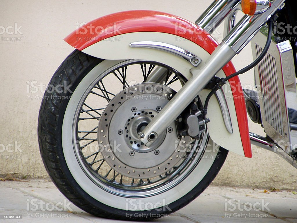 Red shiny front wheel of a motorcycle royalty-free stock photo