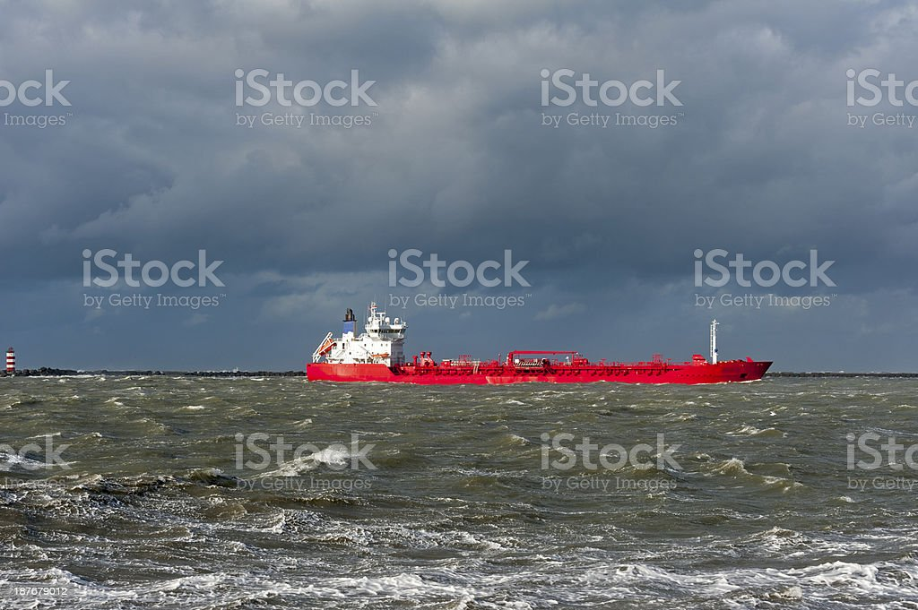 red ship on very rough sea during a storm royalty-free stock photo