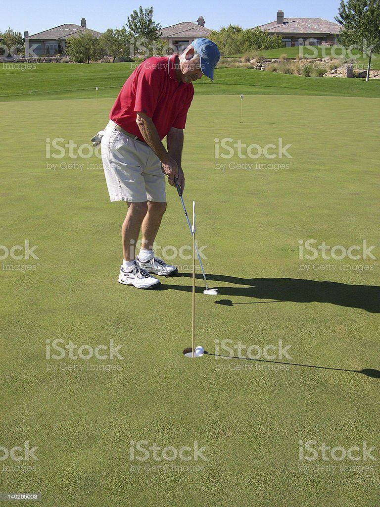 Red Shirt Golfer royalty-free stock photo