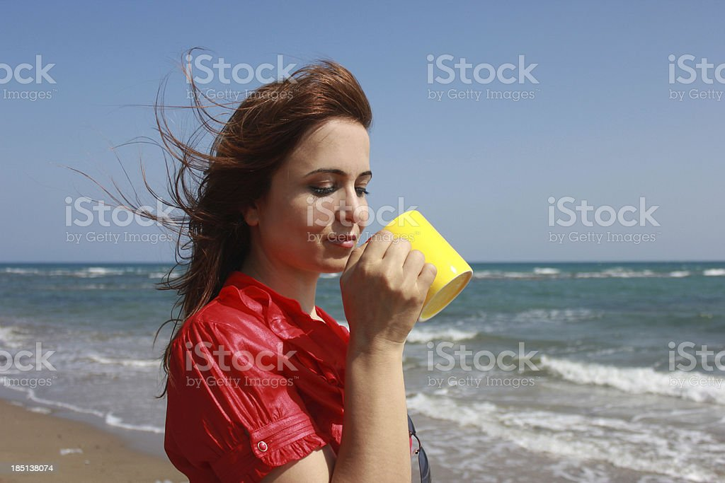 red shirted woman who drinks water royalty-free stock photo