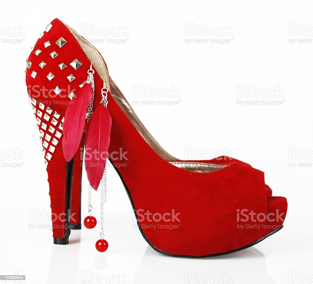 Red shoe and earrings stock photo