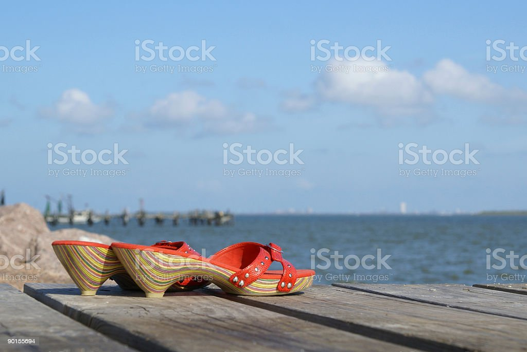 Red shoes on a pier stock photo