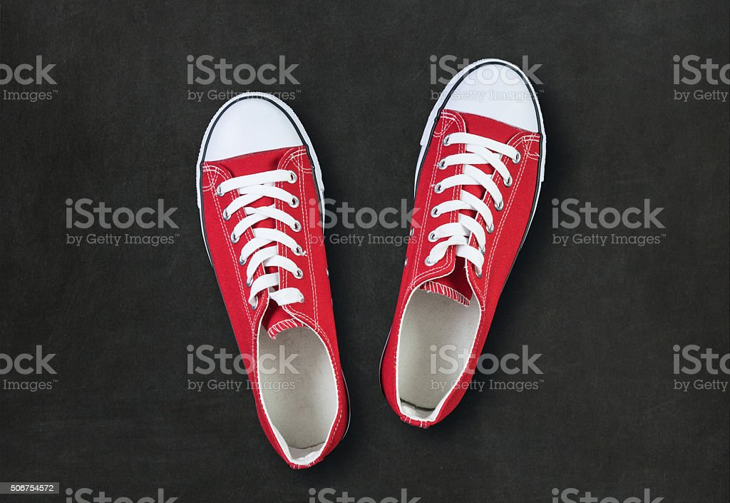 red shoes on black background with space for text stock photo