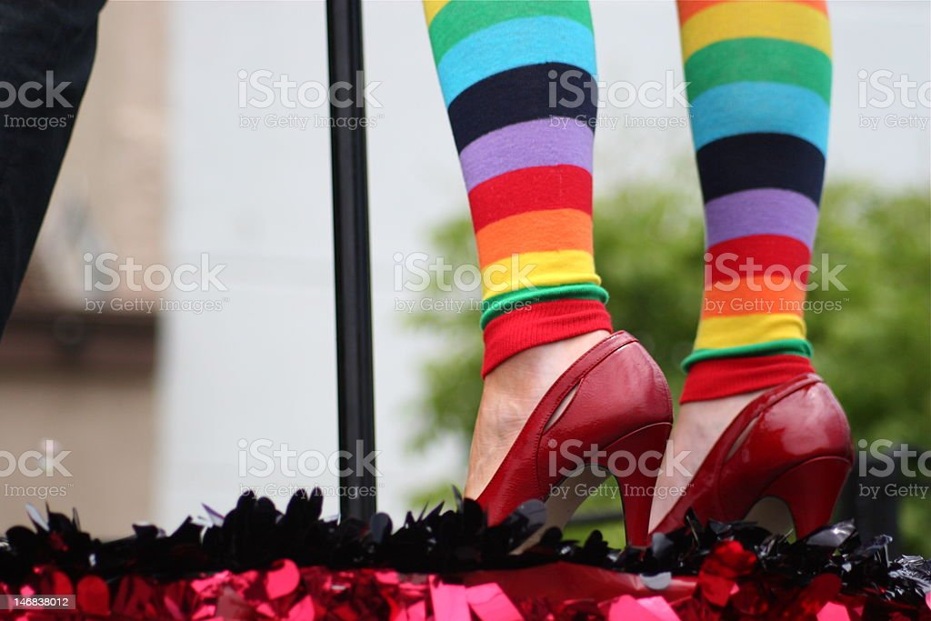 Red shoes on colorful legs stock photo