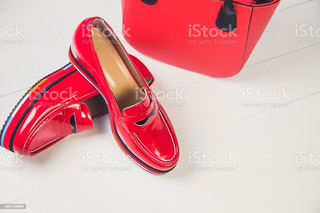 red shoes, stylish patent leather shoes stock photo