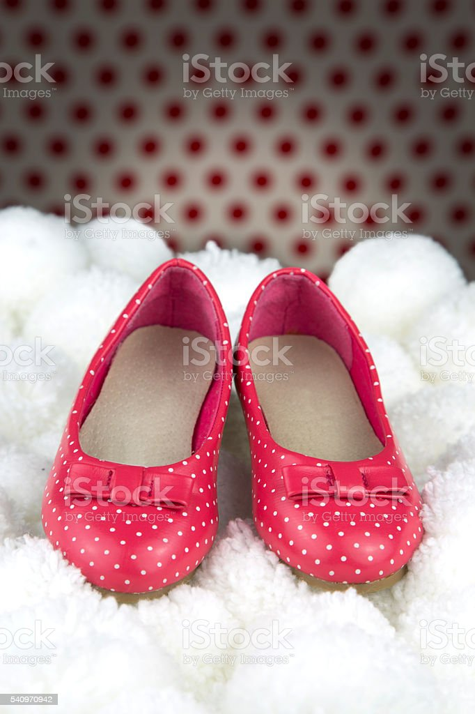 red shoes with polka dots for girls stock photo