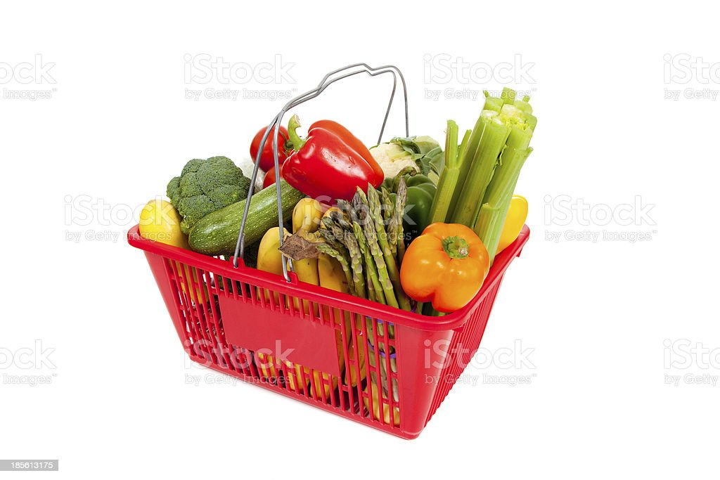 Red shopping basket with vegetables on white royalty-free stock photo