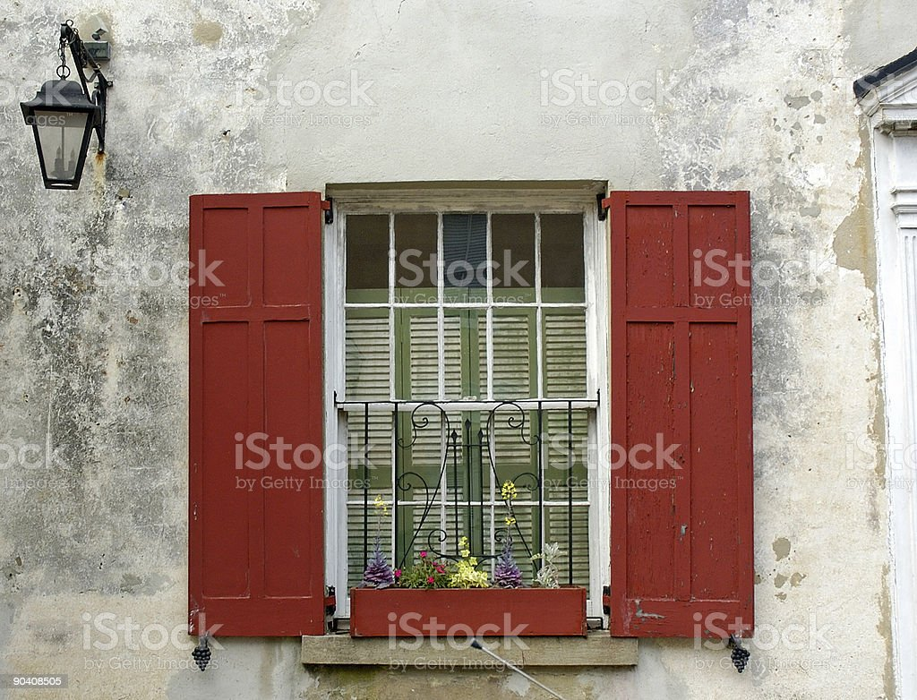 Red Shuttered Window with a flower box royalty-free stock photo