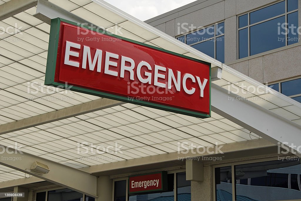 Red sign hanging that says emergency stock photo
