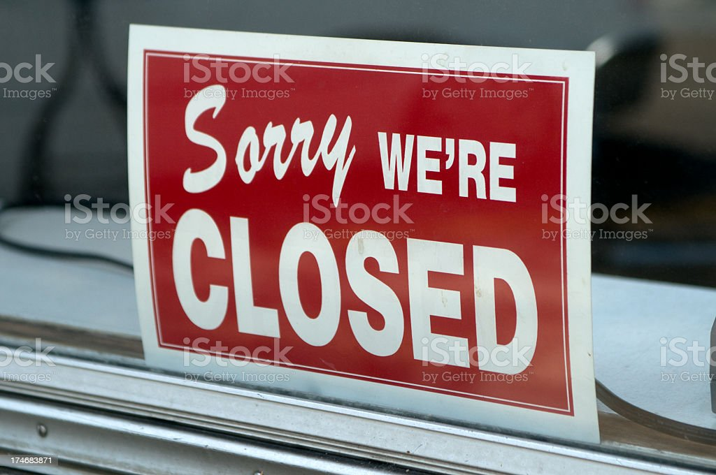 Red sign in window stating Sorry we're closed stock photo
