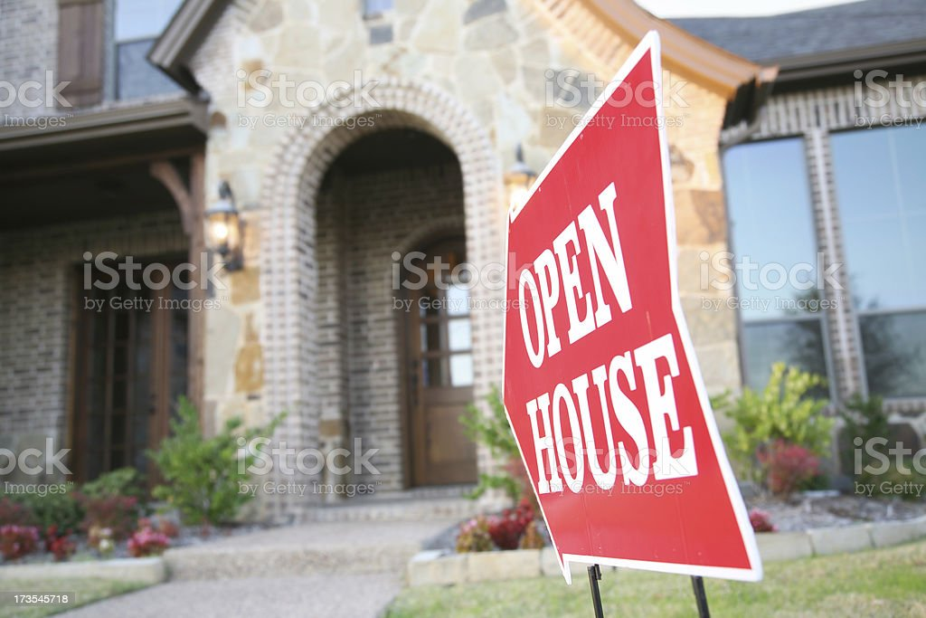 Red Sign Pointing To An Open House stock photo