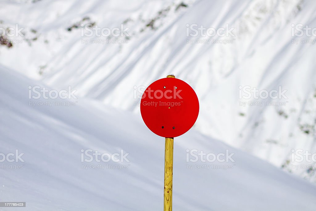 Red Sign with Snowy Background royalty-free stock photo