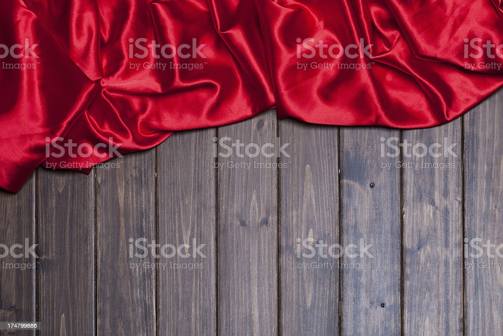 red silk on wooden background stock photo