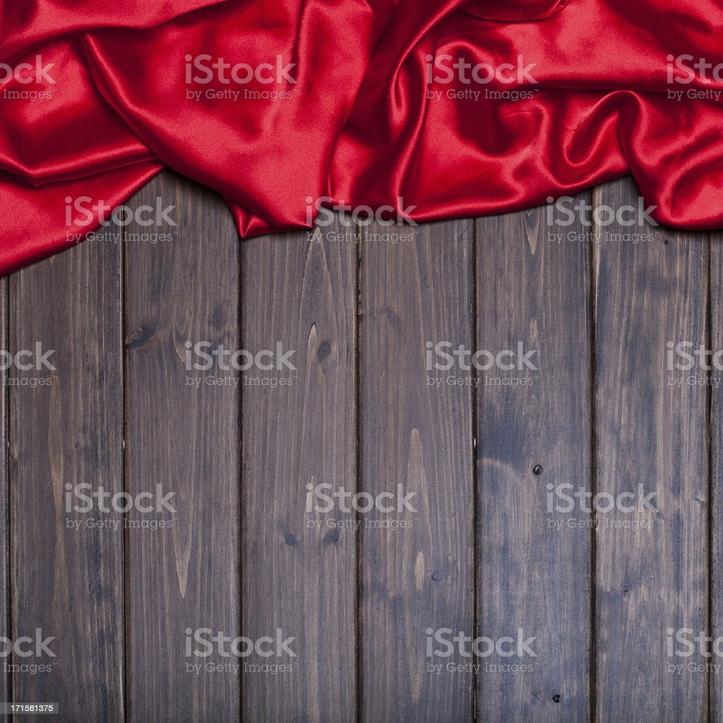 red silk over wooden background stock photo