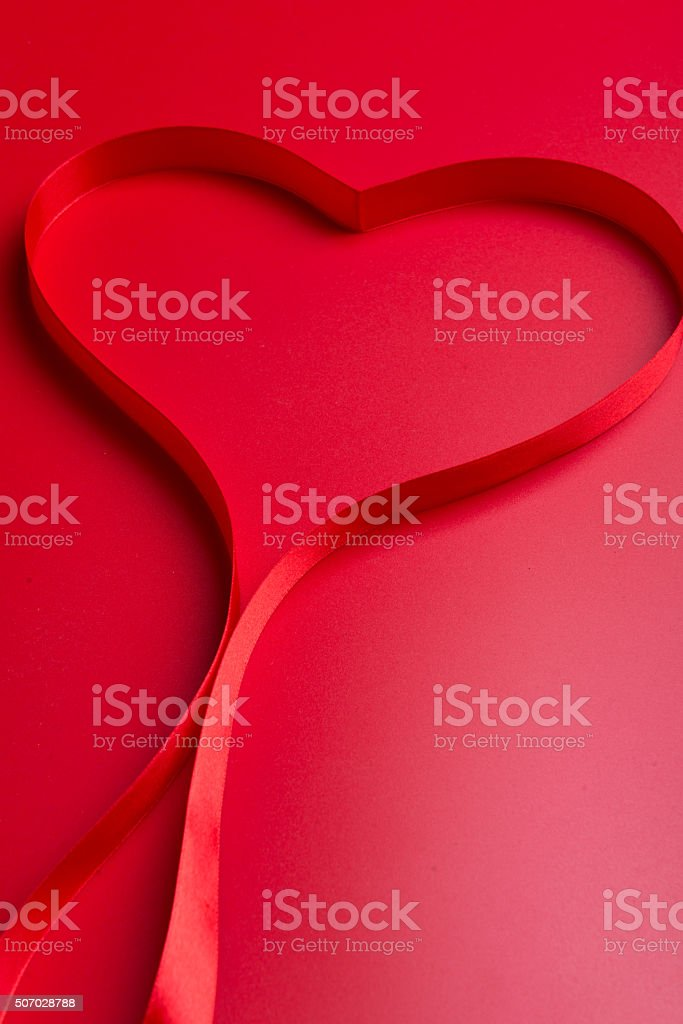 red silk ribbon stock photo
