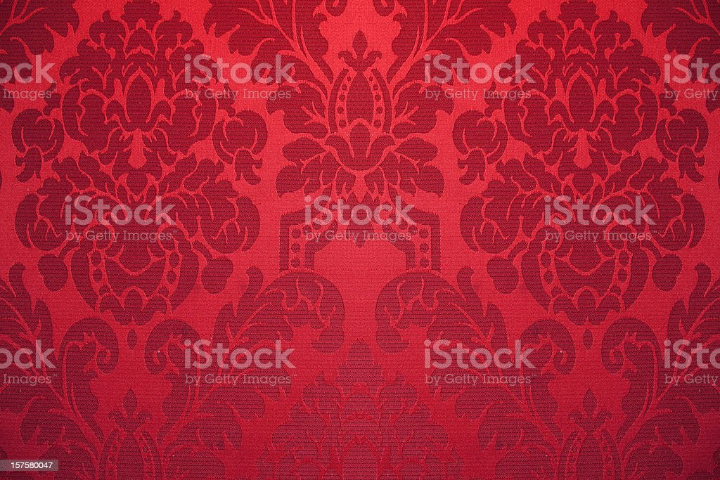 red silk wallpaper with ornaments stock photo