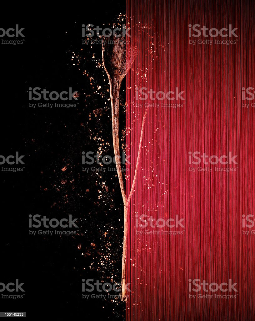 Red silk with dried plants on soil stock photo