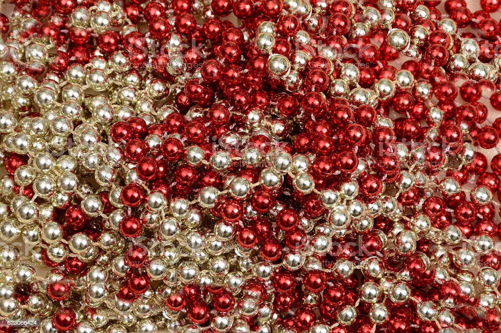 Red Silver Christmas Mardi gras beads background stock photo